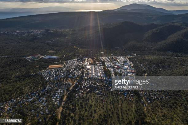 Picture taken on December 1, 2019 shows an aerial view of the official refugee camp of Moria and the makeshift camp around it, on the island of...