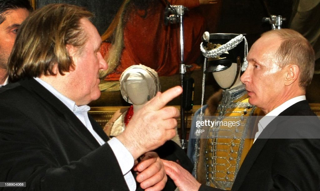 A picture taken on December 11, 2010, shows Russia's President, then Prime Minister, Vladimir Putin (R) speaking with French actor Gerard Depardieu (L) as they tour Russky (Russian) Museum in St. Petersburg. Putin granted today fast-track citizenship to Depardieu after the movie star complained about the French Socialist government's proposed 75 percent tax on the rich.The decision appears to give Depardieu -- a frequent guest of the Moscow celebrity circuit who nonetheless never asked for a Russian passport -- the right to pay the 13 percent tax levied in Russia on everyone from billionaires to the poor.