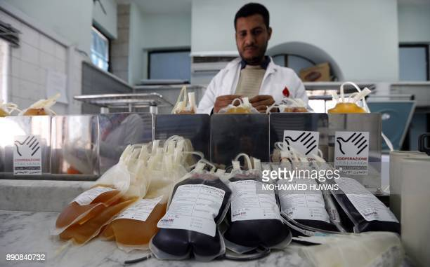 A picture taken on December 12 2017 shows collected blood bags lying prior to storage at a blood transfusion centre in the Yemeni capital Sanaa / AFP...