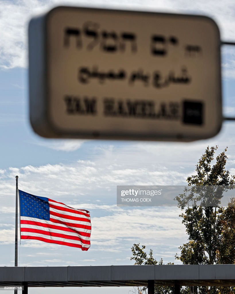 A picture taken on December 12, 2017, shows the US flag flying over the US consulate building complex in Jerusalem. The Middle East saw few days of protests over US President Donald Trump's declaration of Jerusalem as Israel's capital, while further global condemnation followed the deeply controversial move. Israel sees the entire city as its undivided capital, while the Palestinians want the eastern sector as the capital of their future state. /