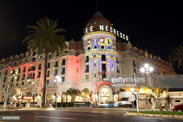 A picture taken on December 13 2016 shows 'Le Negresco' illuminated by Gaspare Di Caro during the Christmas holiday season in the French Riviera city...