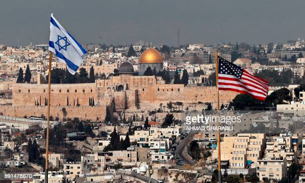 TOPSHOT A picture taken on December 13 shows the Israeli and US flags placed on the roof of an Israeli settlement building in East Jerusalem and...