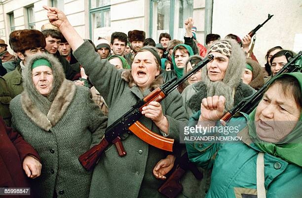 Picture taken on December 15 1994 shows Chechen women during an antiRussia rally in front of the Chechen parliament building in Grozny Russia on...