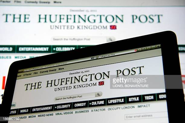 A picture taken on December 15 2011 in Paris shows computer screens featuring a page of the Huffington Post website The Huffington Post is teaming up...