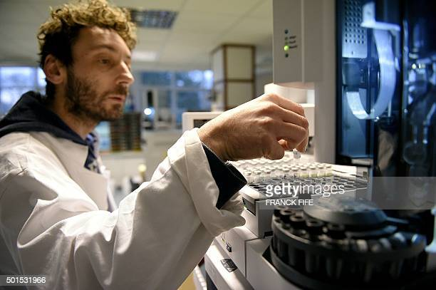 A picture taken on December 15 2015 shows a technician at work at the French national antidoping laboratory in ChatenayMalabry outside Paris / AFP /...