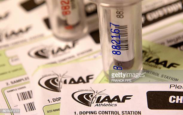 A picture taken on December 15 2015 shows two blood samples of an athlete about to be analyzed at the French national antidoping laboratory in...