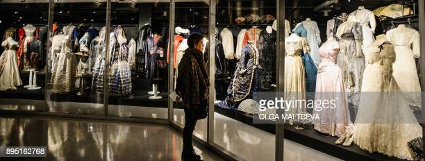 A picture taken on December 15 2017 shows a woman visiting the Costume Gallery a permanent exhibition highlighting the clothes dating from the 18th...