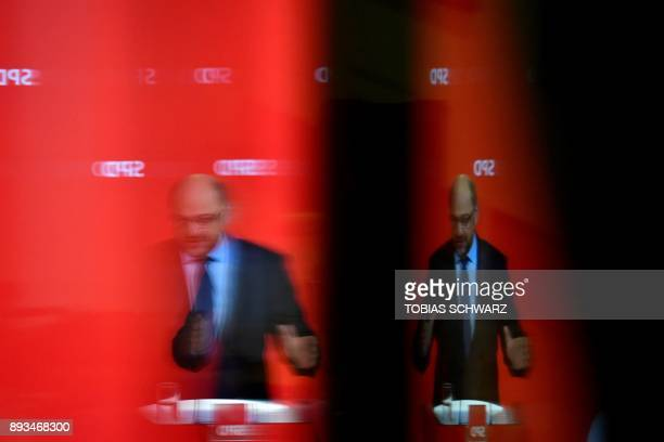 A picture taken on December 15 2017 shows reflections of the leader of the Social Democratic Party Martin Schulz as he speaks during a press...