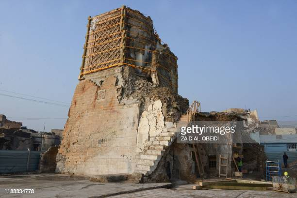 A picture taken on December 15 shows the remaining base of the AlHadba leaning minaret in Mosuls warravaged old town during its reconstruction In...