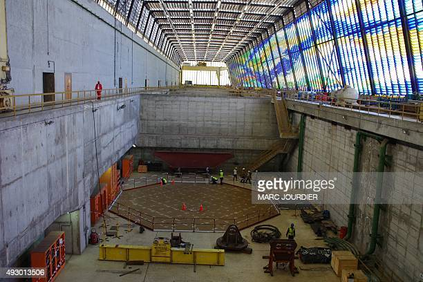 A picture taken on December 16 2013 in Inga shows ongoing renovation works inside Inga 2 electricity production units turbine hall at Inga...