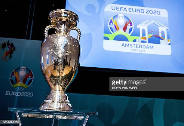 A picture taken on December 16 2016 shows the EURO 2020 UEFA European Championship trophy during the launch of the Amsterdam's logo for the EURO 2020...