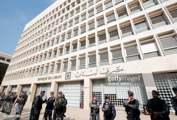 A picture taken on December 16 shows Lebanese policemen standing guard outside the Central Bank in the capital Beirut
