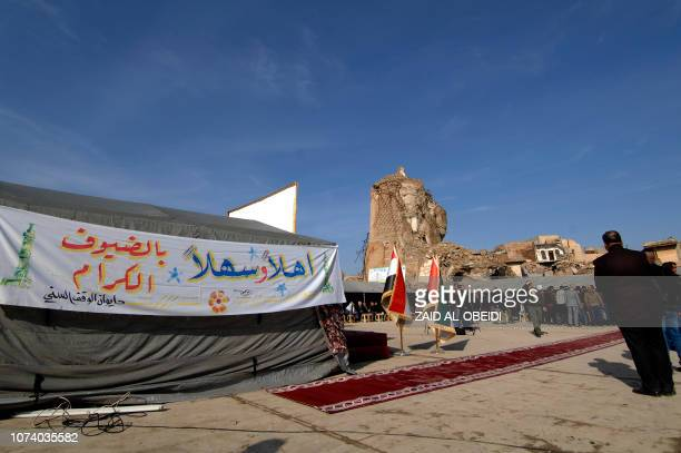 A picture taken on December 16 shows people attending the placing of the cornerstone ceremony for the rebuilding of the Great Mosque of AlNuri and...