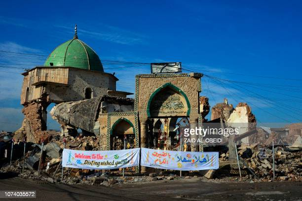 TOPSHOT A picture taken on December 16 shows the Great Mosque of alNuri and the remains of AlHadba leaning minaret in Mosuls warravaged Old City...