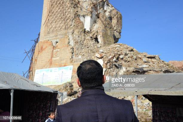 A picture taken on December 16 shows the remains of 'AlHadba' leaning minaret in Mosuls warravaged Old City during the placing of the corner stone...