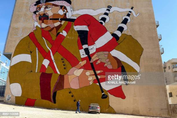 A picture taken on December 17 2017 shows a graffiti mural on a wall in the Jordanian capital Amman A tiny group of graffiti artists are on a mission...