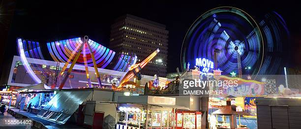 A picture taken on December 18 2012 at night shows the lights of a funfair in Rennes western France AFP PHOTO DAMIEN MEYER