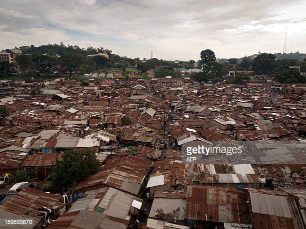 A picture taken on December 18 2012 shows a general view of the Kataanga slum in the Ugandan capital Kampala where two sisters both professional...