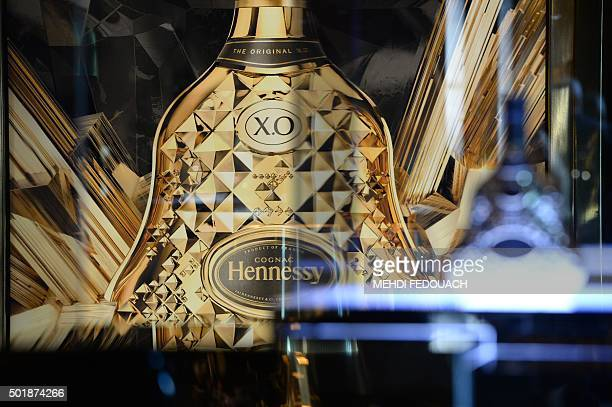 A picture taken on December 18 2015 shows a publicity showing a cognac bottle at the cognac estate of Hennessy company in Cognac La Maison Hennessy...