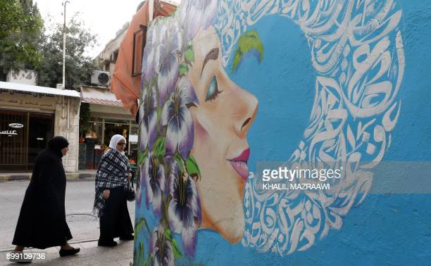 A picture taken on December 18 2017 shows a graffiti mural on a wall in the Jordanian capital Amman A tiny group of graffiti artists are on a mission...