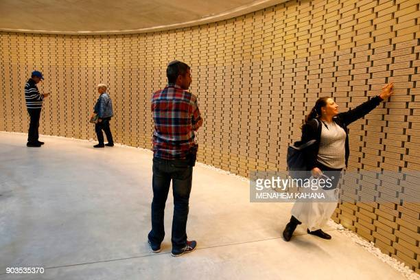 A picture taken on December 18 2017 shows Israelis visiting the National Memorial Hall for Israels Fallen next to the Mount Herzl military cemetery...