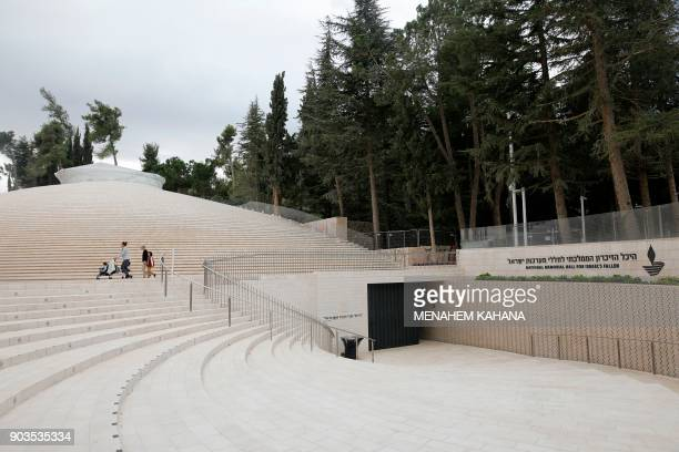 A picture taken on December 18 2017 shows Israelis walking outside the National Memorial Hall for Israels Fallen next to the Mount Herzl military...