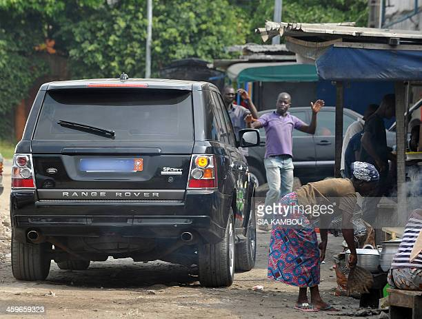 A picture taken on December 19 2013 shows a Range Rover car in a street of the city of Abidjan Porsches Range Rovers and even Maseratis luxury cars...