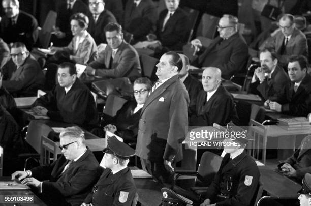 Picture taken on December 20 1963 shows defendants with their lawyers and policmen during the first Auschwitz trial at the plenary hall of the city...