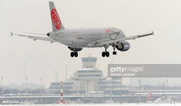 Picture taken on December 20 2010 shows an airplane of Austrian airline Niki landing at Tegel airport in Berlin British Airways owner IAG announced...