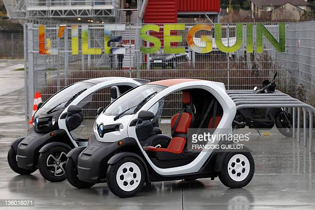 Picture taken on December 20, 2011 shows new Renault electric cars Twizy Z.E, on a test track, at the Ile Séguin test centre for electric vehicles in...
