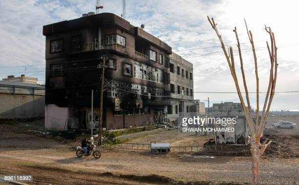 TOPSHOT A picture taken on December 20 2017 shows the burnt premises of the Kurdistan Islamic Union party in the city of Raniya 130 kilometres north...