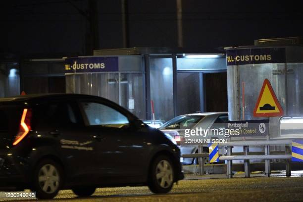 Picture taken on December 21 in Malmo, shows cars in line at the customs of the border crossing on the Oresund Bridge, which connects Denmark and...