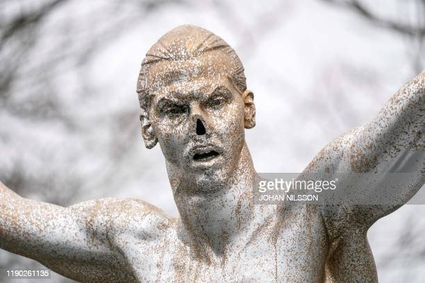 A picture taken on December 22 2019 shows a detail of the bronze statue of iconic football player Zlatan Ibrahimovic after it was vandalised and had...