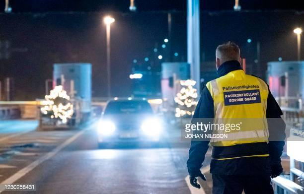 Picture taken on December 22, 2020 in Malmo, Sweden, shows control patrols and vehicles at the border crossing on the Oresund Bridge, which connects...