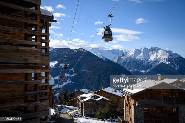 Picture taken on December 22 shows a gondola lift in the Swiss Alpine resort of Verbier, well known by british ski holiday makers, amid the Covid-19...
