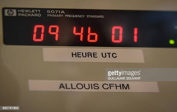 A picture taken on December 23 2016 shows the screen of the atomic clock inside the TDF radiobroadcaster building in Allouis near Vierzon central...