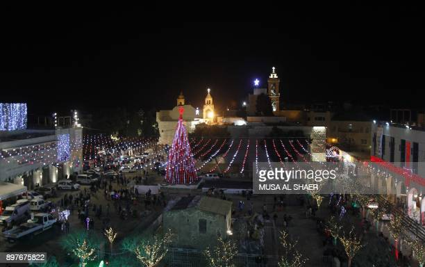 A picture taken on December 23 2017 shows a general view of Christmas decorations in the Manger Square and the Church of the Nativity in the...