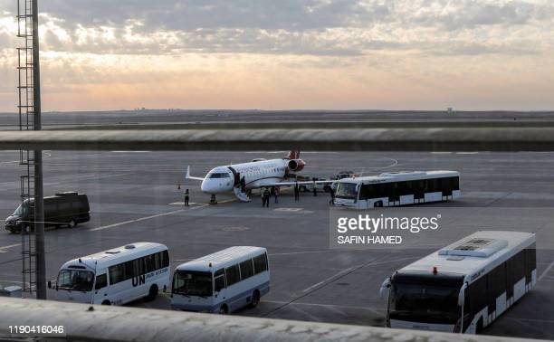 A picture taken on December 24 shows a view of a Fly Baghdad Bombardier CRJ200ER on the tarmac at Erbil International Airport in the capital of the...