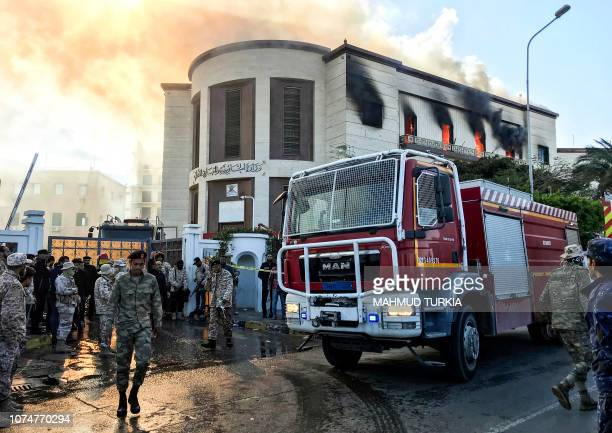TOPSHOT A picture taken on December 25 2018 shows a firetruck and security officers at the scene of an attack outside the Libyan foreign ministry...