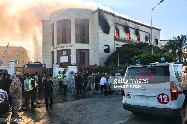 A picture taken on December 25 2018 shows ambulances paramedics and security officers at the scene of an attack outside the Libyan foreign ministry...