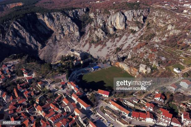 TOPSHOT A picture taken on December 27 2017 shows a general view of Gospin Dolac stadium used by the Croatian football club NK Imotski in the town of...
