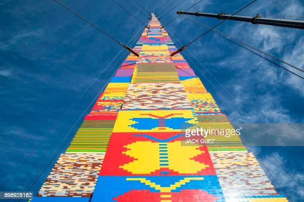 TOPSHOT A picture taken on December 27 2017 shows a LEGO tower under construction in Tel Aviv's Rabin Square as the city attempts to break Guinness...