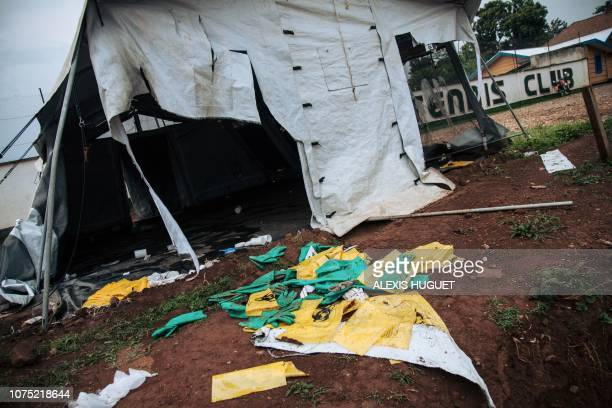A picture taken on December 27 2018 shows protective equipments for Ebola care left on the ground next to ransacked tents by demonstrators at the...