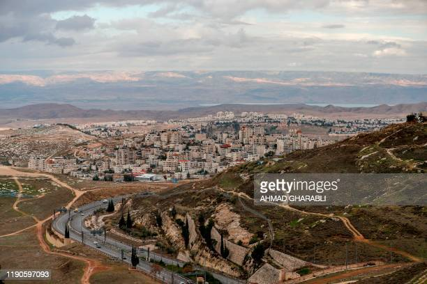 Picture taken on December 27, 2019 shows Israel's controversial separation barrier between the West Bank village of al-Azayem and the Jewish...
