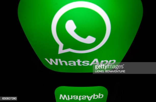 A picture taken on December 28 2016 in Paris shows the logo of WhatsApp mobile messaging service / AFP PHOTO / Lionel BONAVENTURE
