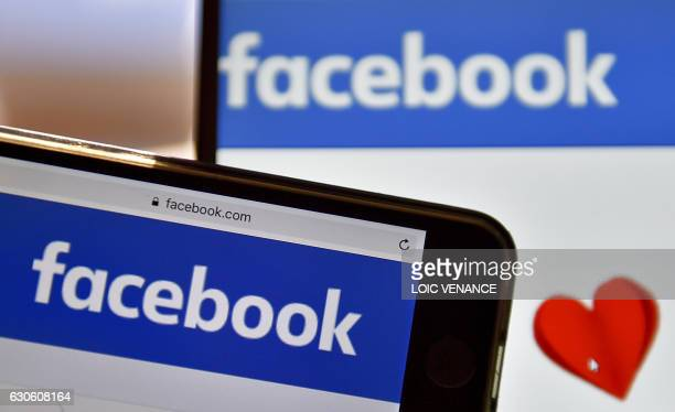 A picture taken on December 28 2016 in Vertou western France shows logos of US online social media and social networking service Facebook / AFP PHOTO...