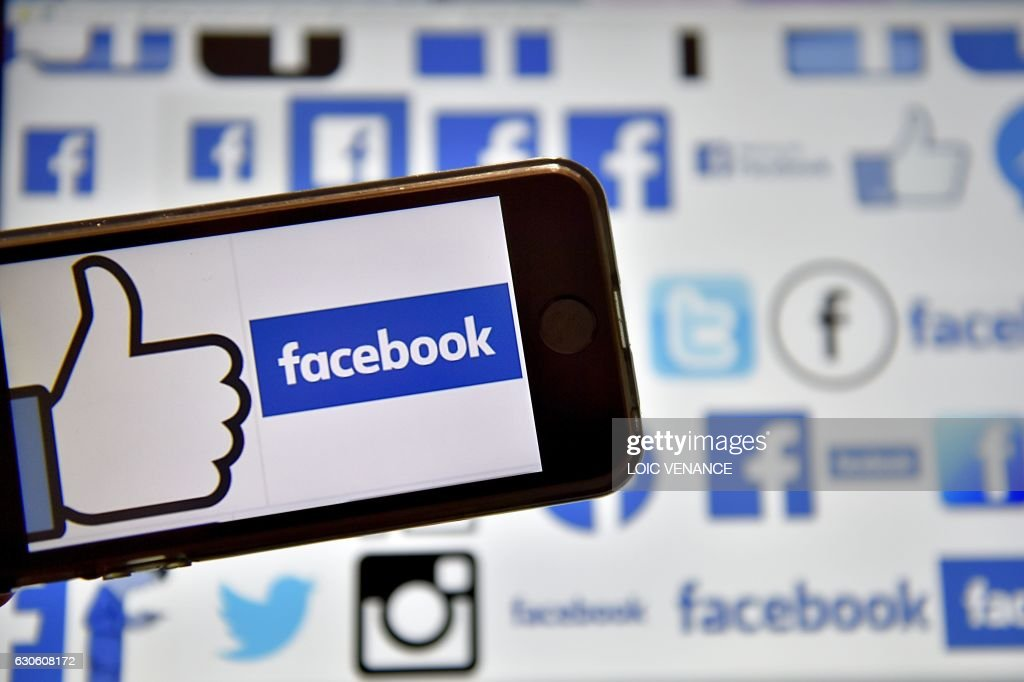 A picture taken on December 28, 2016 in Vertou, western France, shows logos of US online social media and social networking service Facebook. /