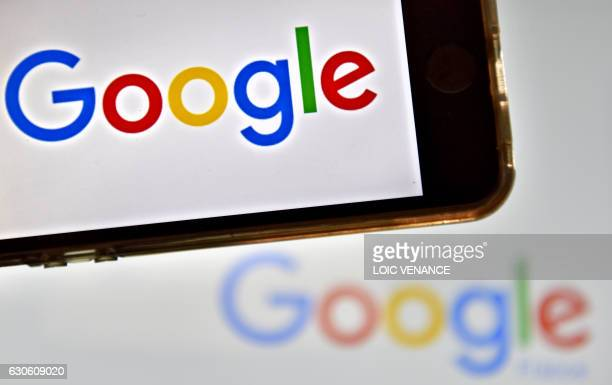 A picture taken on December 28 2016 in Vertou western France shows logos of US multinational technology company Google / AFP PHOTO / LOIC VENANCE