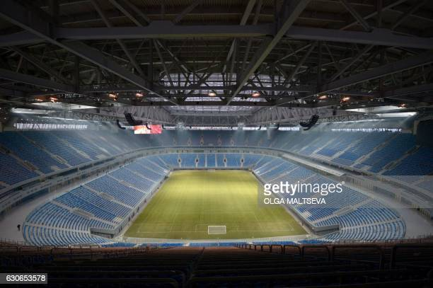 A picture taken on December 29 2016 shows a view of the inside of Krestovsky football stadium also known as Zenit Arena and currently under...