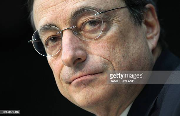 FILES Picture taken on December 3 2011 shows Mario Draghi President of the European Central Bank giving his first press conference in his new office...